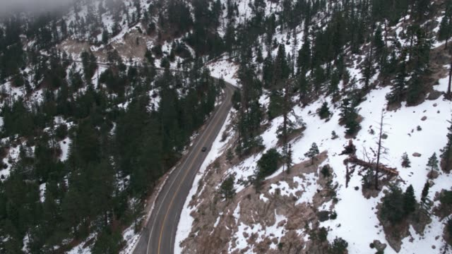 car driving on mountain road with snow - angeles national forest stock videos and b-roll footage