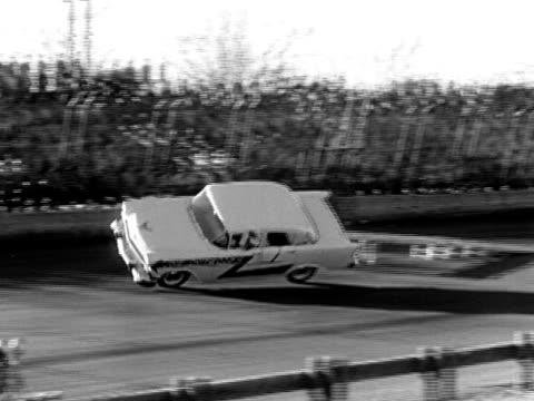 b/w ws pan 1956 car driving on race track, joie chitwood thrill show, usa - シボレー点の映像素材/bロール