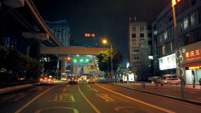 car driving on road at night,chongqing,china. - in front of stock videos & royalty-free footage