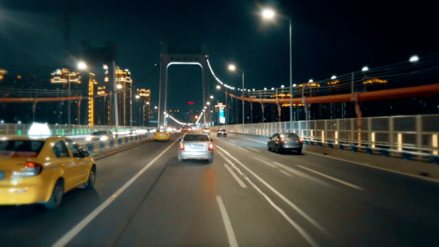 car driving on road at night,chongqing,china. - vanishing point stock videos & royalty-free footage