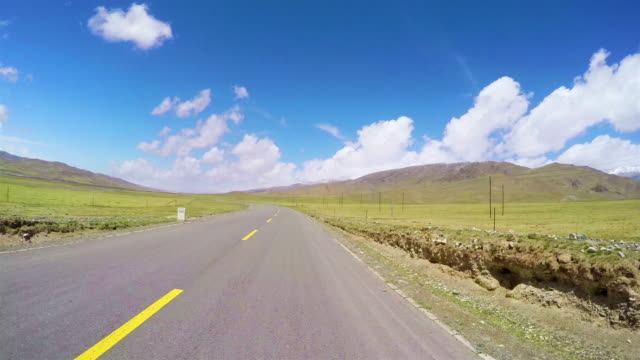 pov car driving on road of pastoral areas/qinghai,china. - car point of view stock videos & royalty-free footage
