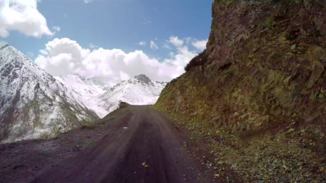 T/L POV Car driving on snowy and winding mountain road/Qinghai,China.