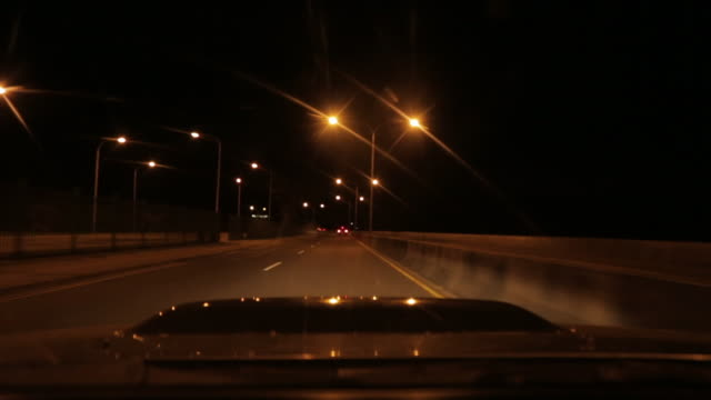 car driving on street at night - windscreen stock videos & royalty-free footage