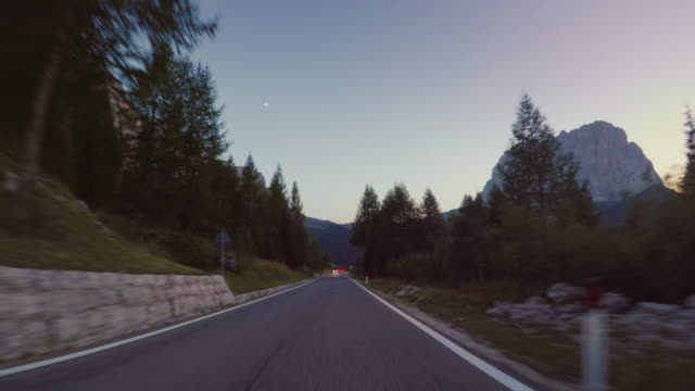 POV car driving on the Dolomites: mountain pass