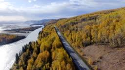 Car driving on the Richardson Highway, Alaska, USA