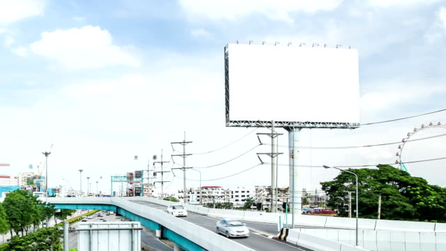 car driving on the road and advertising billboard