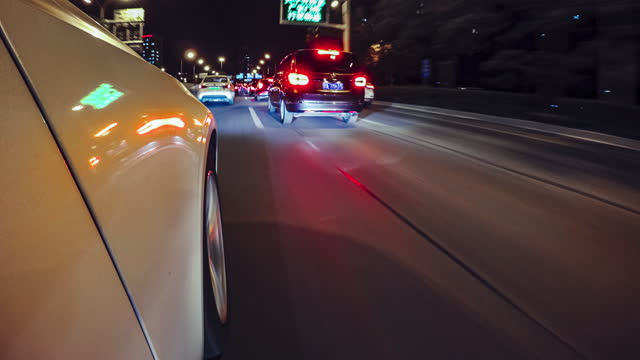 t/l pov car driving on the road at night - tail light stock videos & royalty-free footage