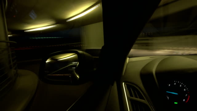 pov t/l car driving on the spiral ramp of a multi-storey car park (dusk) - spiral stock videos and b-roll footage