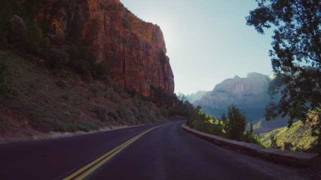 pov car driving on the zion mountain pass in usa - two lane highway stock videos & royalty-free footage
