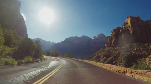 pov car driving on the zion mountain pass in usa - avventura video stock e b–roll