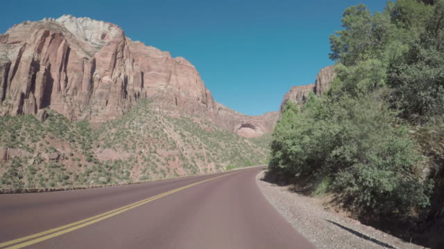 pov car driving on the zion mountain pass in usa - zion national park stock videos & royalty-free footage