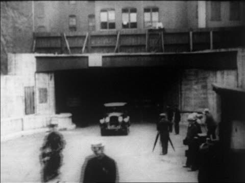 b/w 1927 car driving out of holland tolland on dedication day / newsreel - 1927 stock videos & royalty-free footage