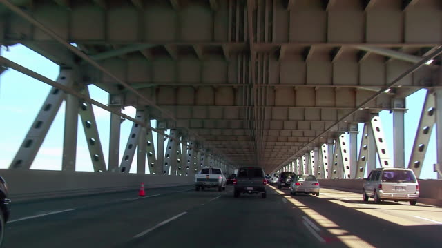 ws car pov driving over bay bridge/ san francisco, california  - girder stock videos & royalty-free footage