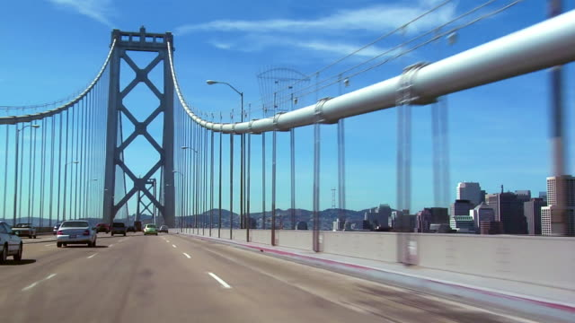 ws car pov driving over bay bridge/ san francisco, california  - road trip stock videos and b-roll footage