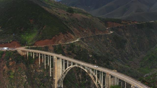 car driving over bixby creek bridge - aerial - bixby creek bridge stock videos & royalty-free footage