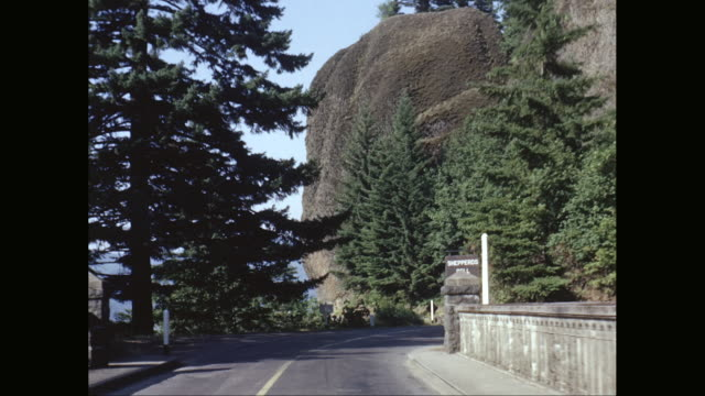 WS Car POV driving over bridge approaching large rock outcropping, Shepard's Dell, Oregon/ United States