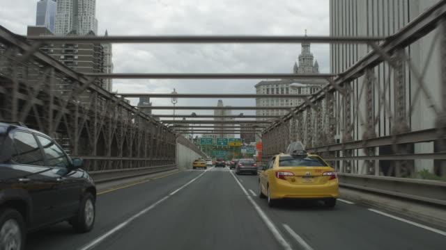 Car POV driving over Brooklyn Bridge into Manhattan