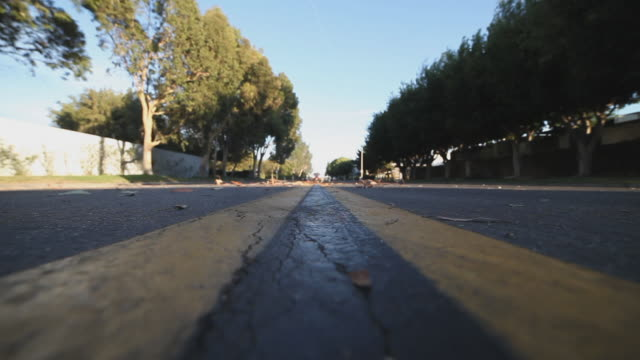ws car driving over camera - autoperspektive stock-videos und b-roll-filmmaterial