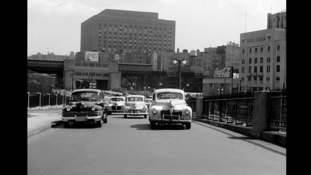Car POV driving past Yankee Stadium onto the Macombs Dam Bridge over the Harlem river into Manhattan Car POV driving past Yankee Stadium on January...