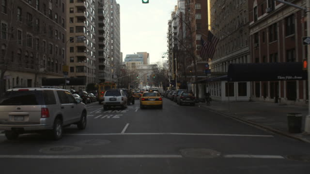 car pov driving south on fifth avenue toward the washington square arch in greenwich village / new york city - sports utility vehicle stock videos and b-roll footage