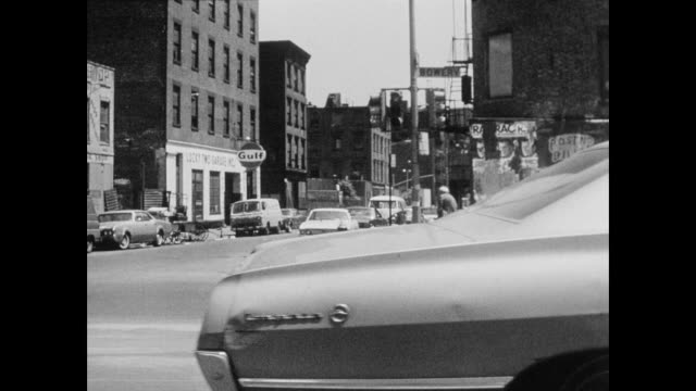Car POV driving south on the Bowery at 1st street