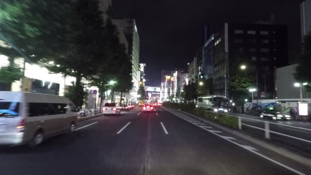 car driving through a business district in tokyo japan. - (war or terrorism or election or government or illness or news event or speech or politics or politician or conflict or military or extreme weather or business or economy) and not usa点の映像素材/bロール