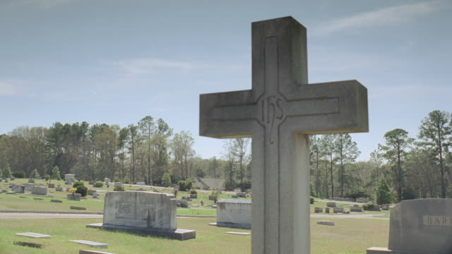 ws car driving through a cemetery / georgia, united states - tombstone stock videos and b-roll footage