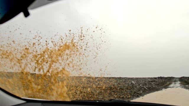 SLO MO POV Car driving through a puddle