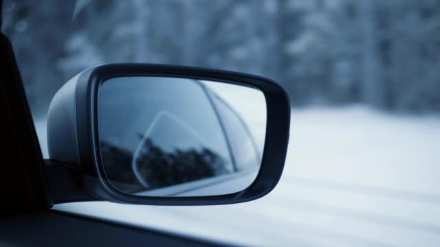 Car driving through a winter landscape hand-held shot