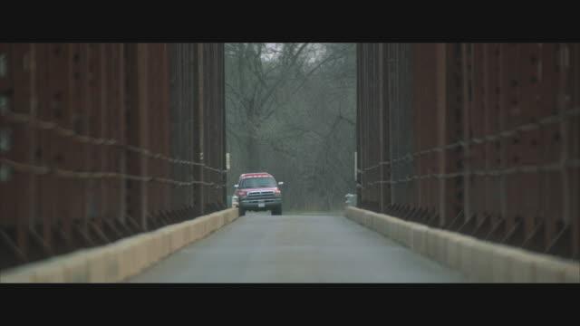 ms, selective focus, cu, car driving through bridge  - symmetry stock videos & royalty-free footage