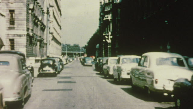 1956 pov car driving through city streets / london, england - 1950 stock videos and b-roll footage