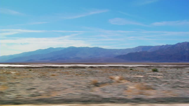 SIDE POV, Car driving through Death Valley National Park, Nevada, USA