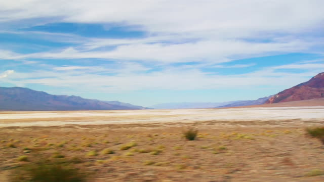 side pov, t/l, car driving through death valley national park, nevada, usa - nevada stock-videos und b-roll-filmmaterial