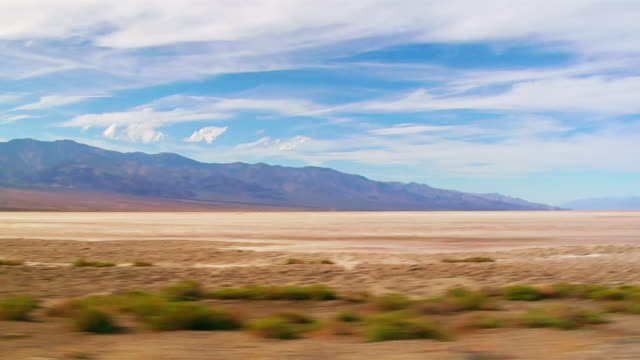 SIDE POV, T/L, Car driving through Death Valley National Park, Nevada, USA