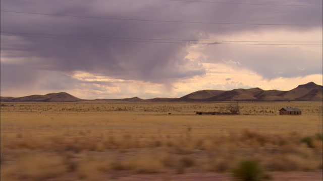 SIDE POV, Car driving through desert, New Mexico, USA