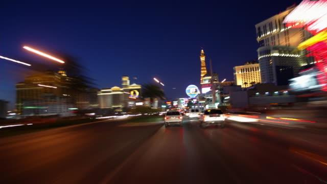 pov, t/l, car driving through downtown at dusk, las vegas, nevada, usa - fan palm tree stock videos & royalty-free footage