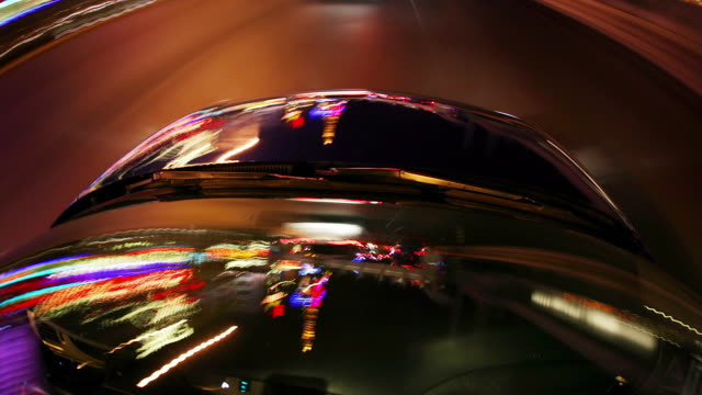 POV, T/L, Car driving through Downtown at night, cityscape reflecting up side down in car, Las Vegas, Nevada, USA