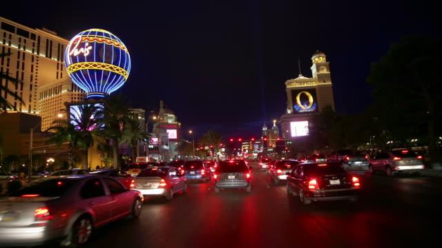 pov, t/l, car driving through downtown at night, las vegas, nevada, usa - fan palm tree stock videos & royalty-free footage