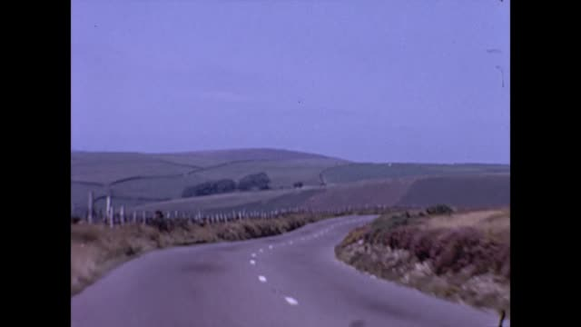 car driving pov through exmoor devon uk 1965 - england stock videos & royalty-free footage