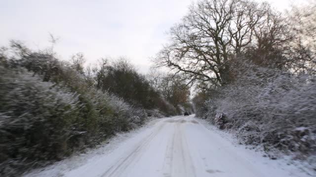 WS POV Car driving through ice covered road / St Albans, Hertfordshire, United Kingdom