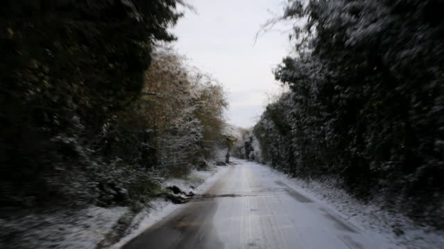 ws pov car driving through ice covered road / st albans, hertfordshire, united kingdom - rear view stock videos & royalty-free footage