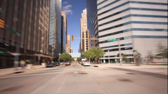 WS T/L POV Car driving through intersections, stop lights, past buildings and streets in Oklahoma City / Oklahoma City, Oklahoma, USA
