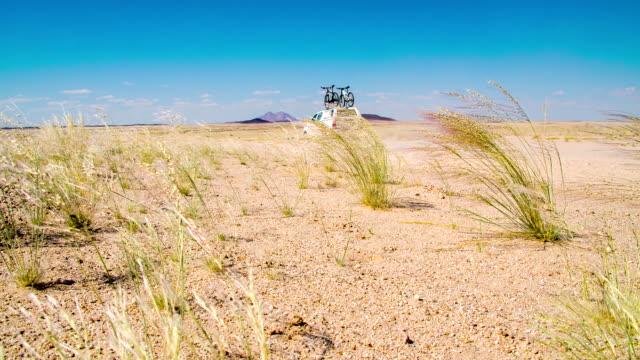 la ds car driving through namibian desert - namibian desert stock videos and b-roll footage