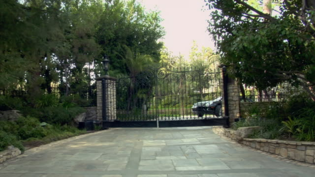 MS, Car driving through opening gate, Beverly Hills, California, USA