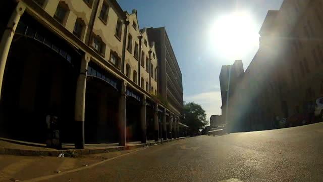 ws car pov driving through pretoria/ south africa - pretoria stock videos & royalty-free footage