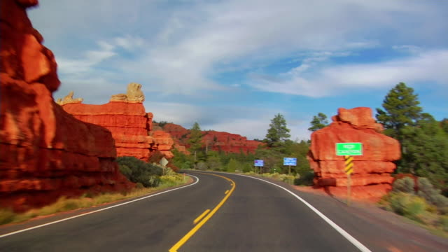 pov, car driving through red canyon, dixie national forest, utah, usa - arrow symbol stock videos & royalty-free footage