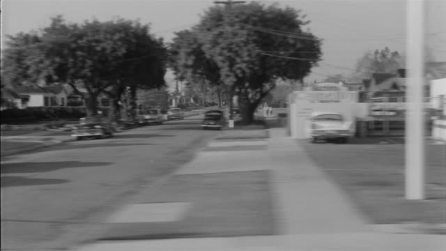 stockvideo's en b-roll-footage met 1955 pov car driving through small business district in southern california / united states - 1955