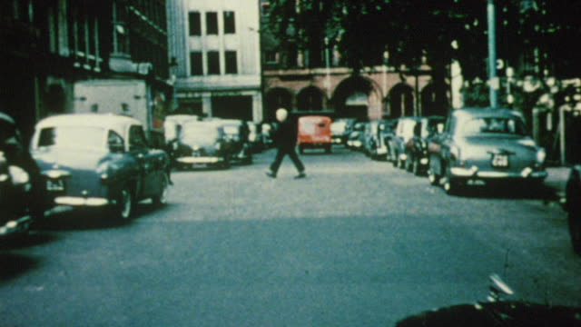 1956 pov car driving through soho square / london, england - 1950 stock videos and b-roll footage