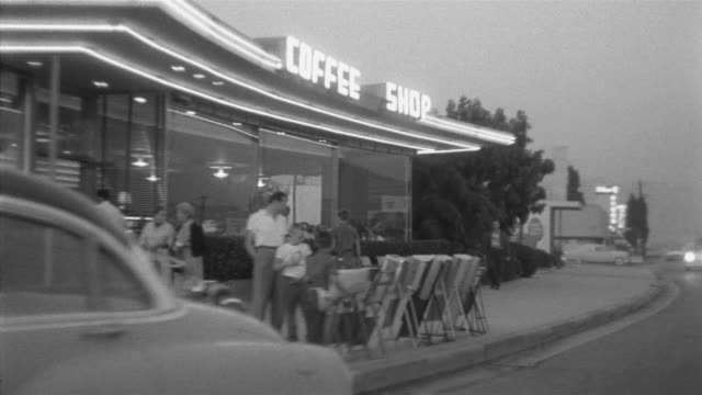 1955 POV Car driving through suburbs and business district / Toluca Lake, Southern California