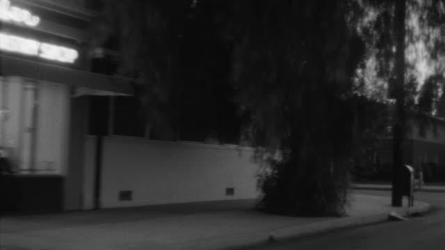 1955 POV Car driving through suburbs, business district / Toluca Lake, Southern California
